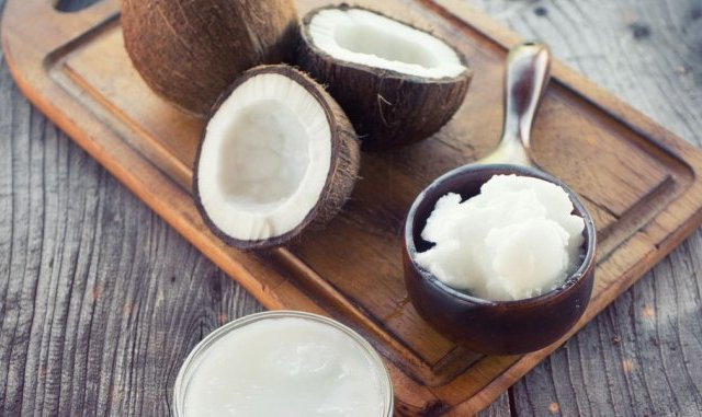 coconut-with-coconut-oil-in-jar-on-wooden-royalty-free-image-857897728-1544753381